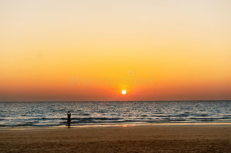 Girl doing yoga at sunrise royalty free stock photos