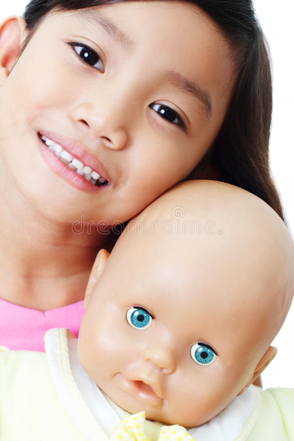Girl With Doll Royalty Free Stock Images