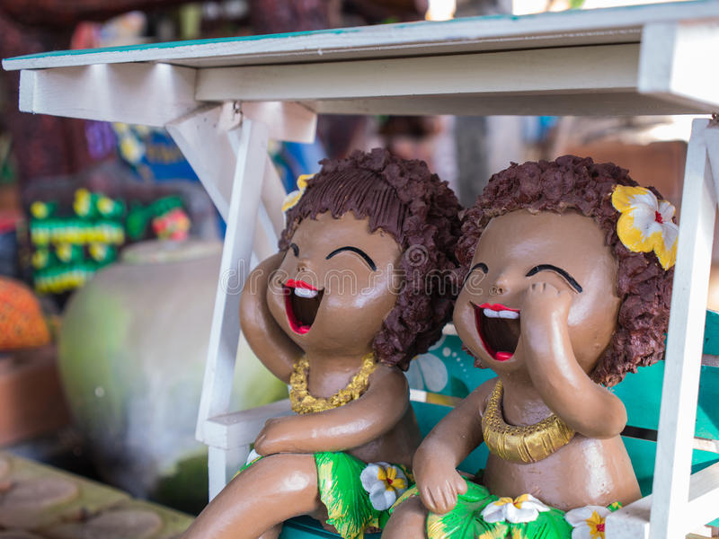 Girl Doll Islanders Laugh in The Swing royalty free stock images