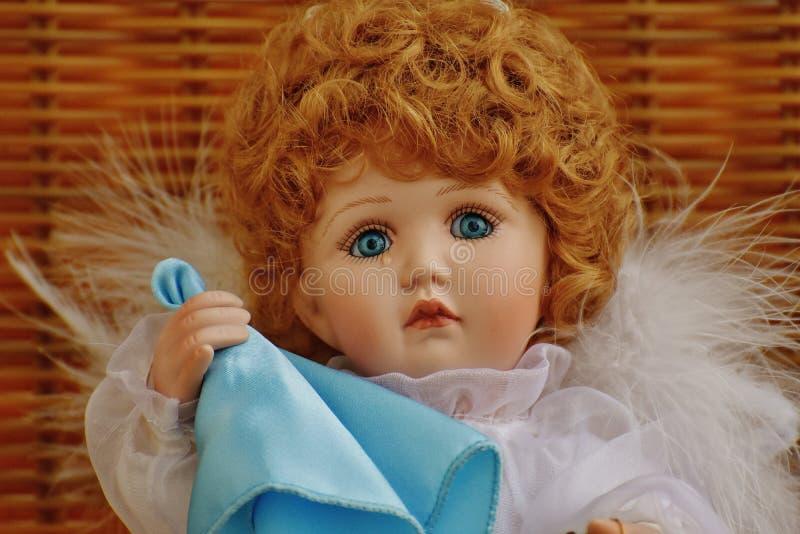 Girl Doll in White Fur Dress Holding Blue Handkerchief stock images
