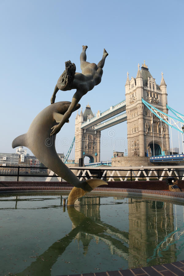 Girl With A Dolphin Statue Near Tower Bridge UK Editorial Stock Photo