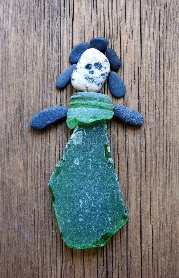 Girl done using sea stones and sea glass, Lithuania royalty free stock photos