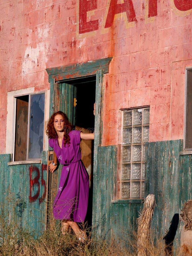 Girl in doorway royalty free stock image