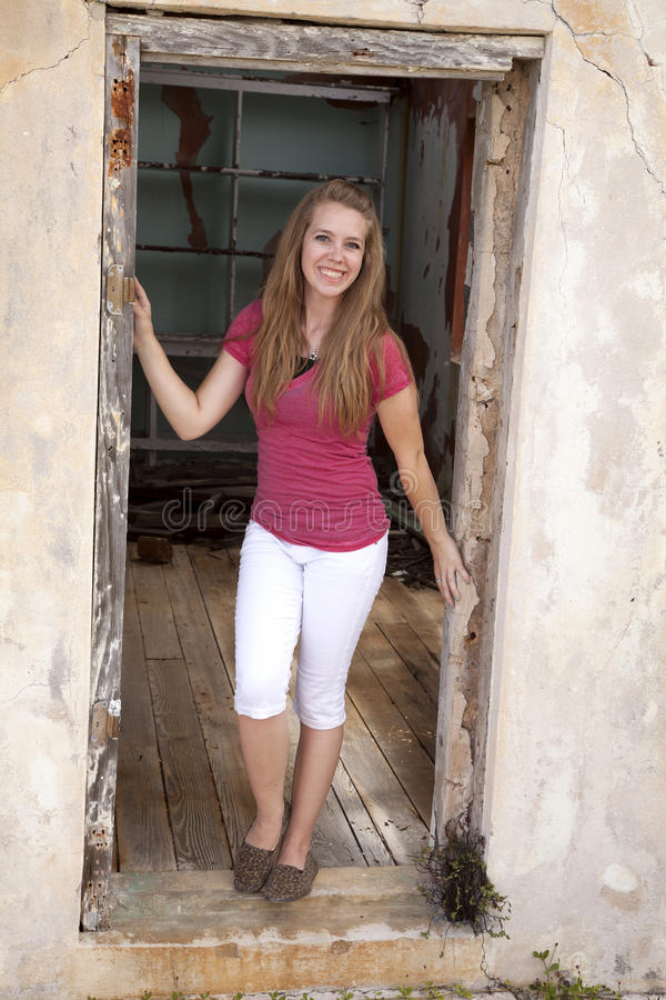 Girl in doorway with smile royalty free stock image