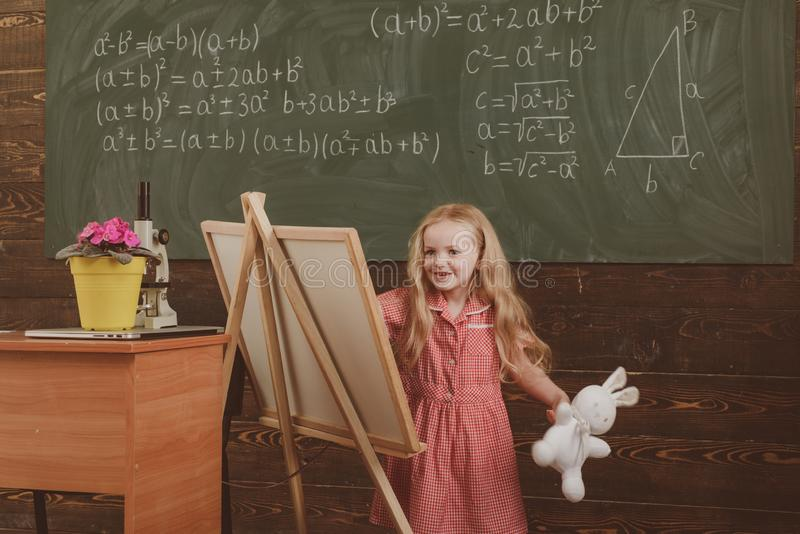 Girl draw picture in art school. Little artist paint on studio easel, art education, vintage filter stock images