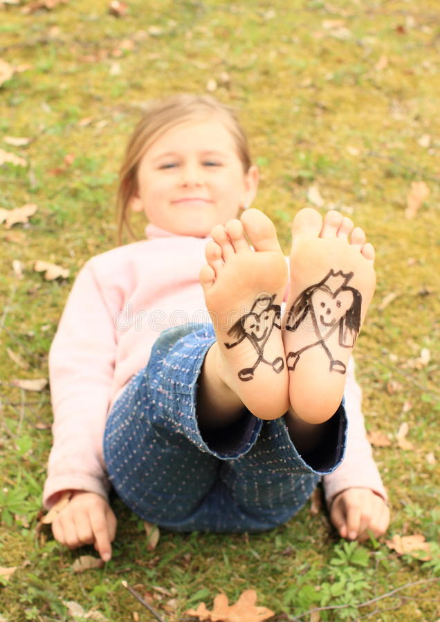 girl with drawen hearts on soles stock image - image of little, love