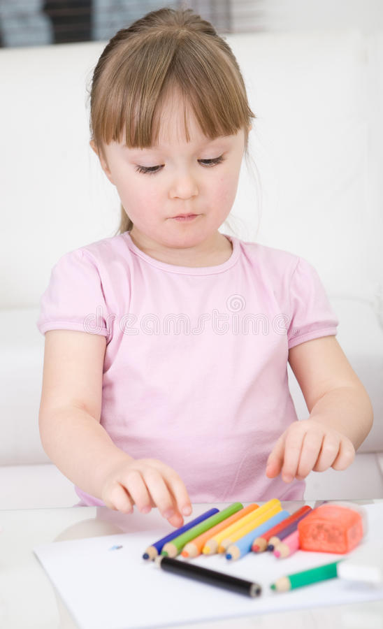 Girl drawing stock photos