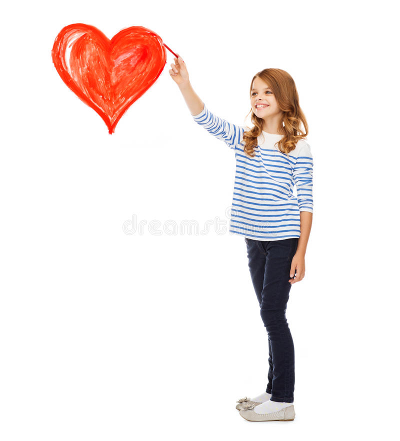 Girl drawing big red heart in the air. Education, school and art concept - cute little girl drawing big red heart in the air royalty free stock image