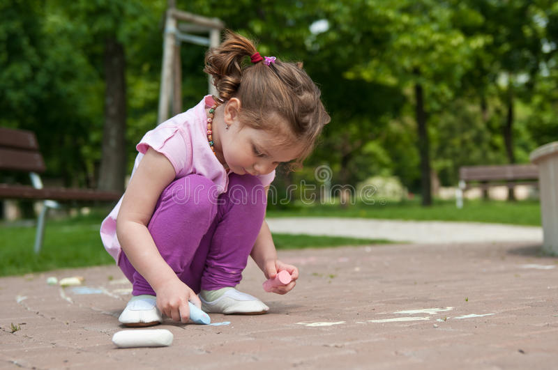 Download Girl drawing with chalk stock image. Image of person - 14346295