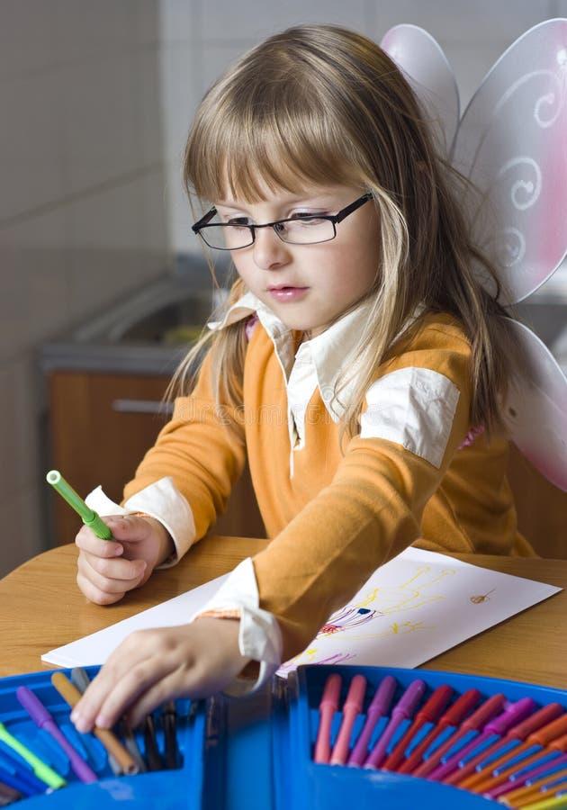 Girl drawing at home stock image