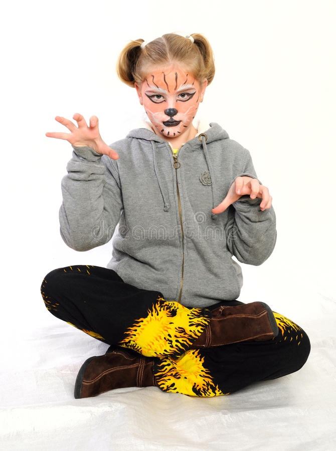 Girl With Drawing By Mask Tiger Royalty Free Stock Photography