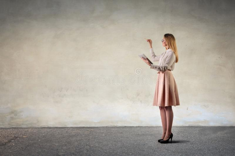 Girl drawing on a neutral background royalty free stock photo