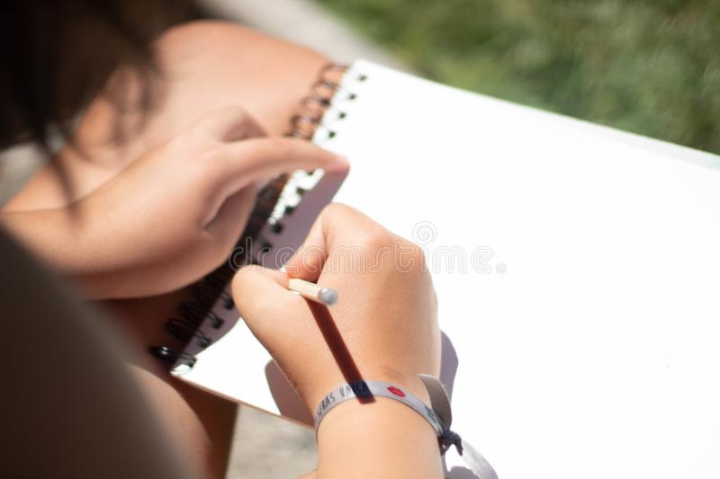 A girl drawing with a pencil royalty free stock photos