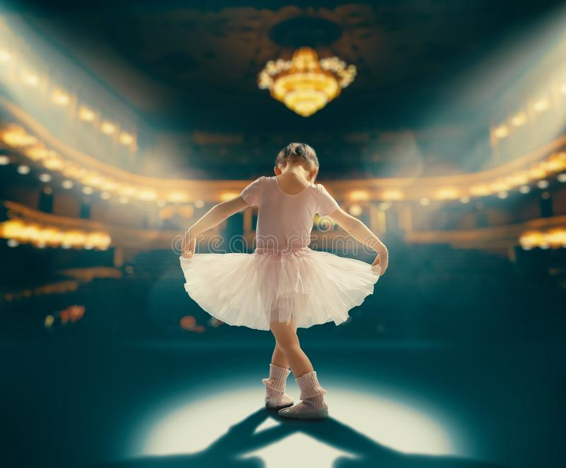 Girl dreaming of becoming a ballerina royalty free stock image