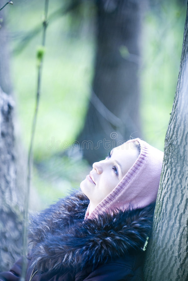 Girl dreaming in the forest stock photos
