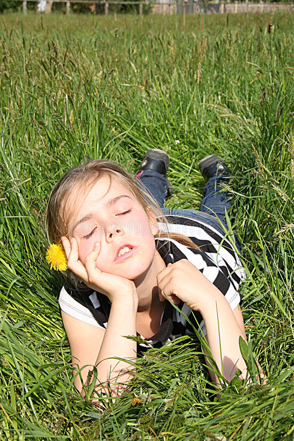 Girl dreaming on a meadow royalty free stock image