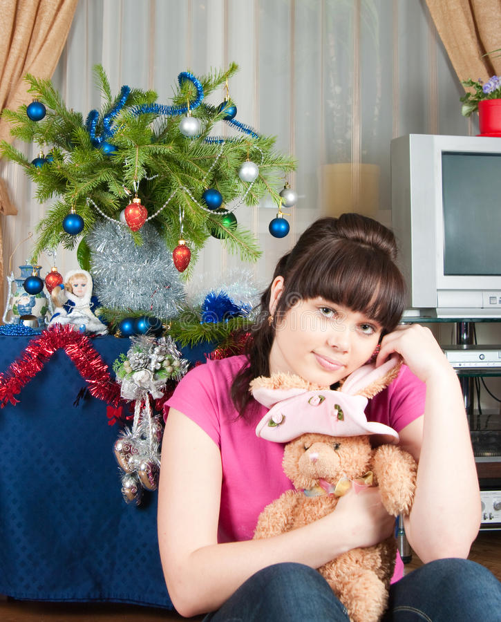 Download The Girl Dreams Of A Christmas Gift Stock Image - Image: 12147787