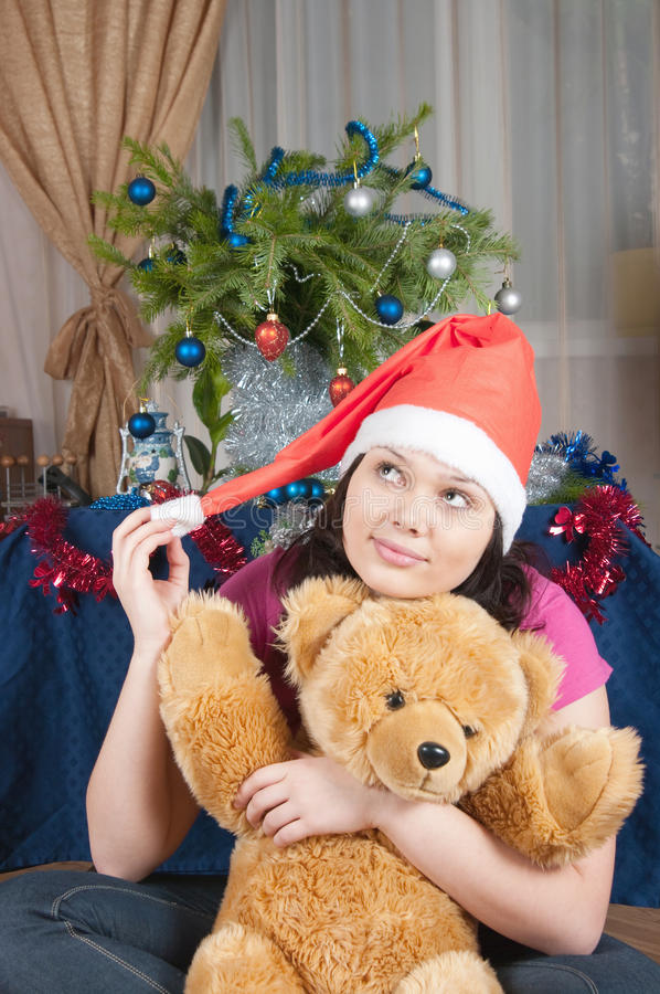 Download The Girl Dreams Of A Christmas Gift Stock Image - Image: 12147871