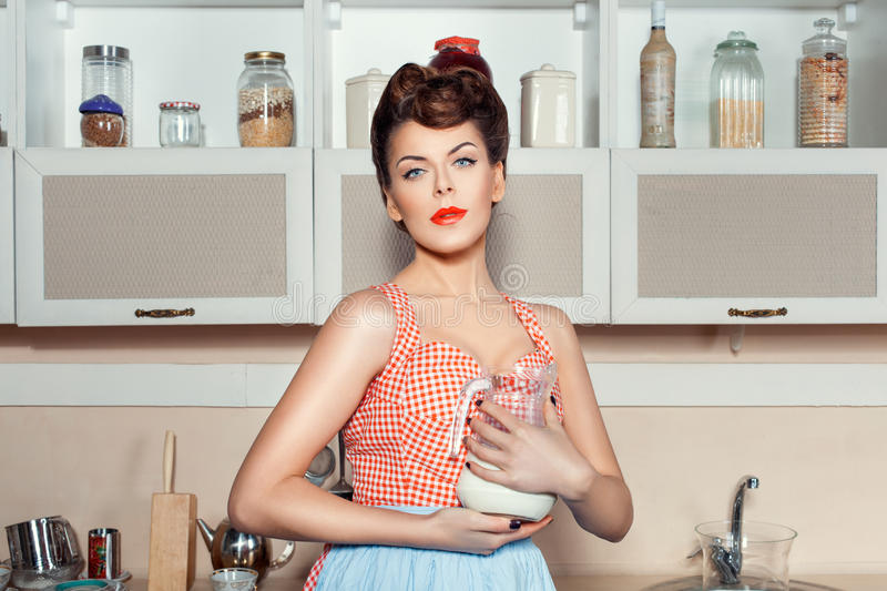 Girl dreams in the kitchen. royalty free stock photos