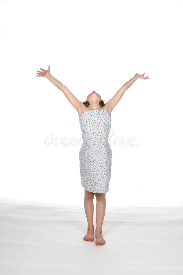 Girl in dress with arms up royalty free stock photo