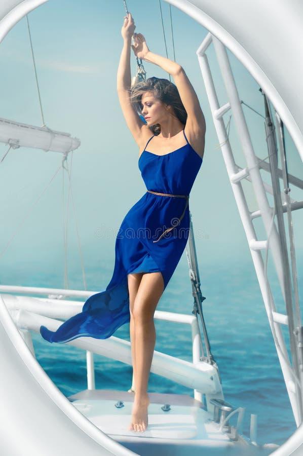Girl dress blue sea yacht stock photos