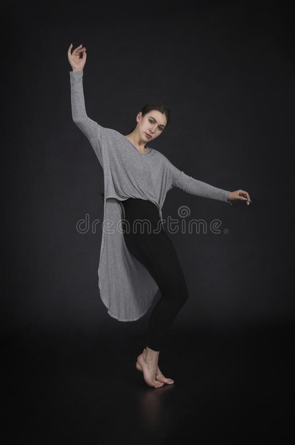 Girl in a dress dances and modern choreography royalty free stock photography