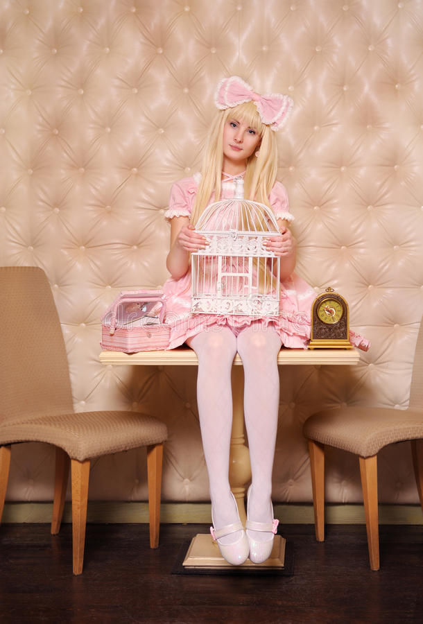 Girl dressed as doll. stock photography