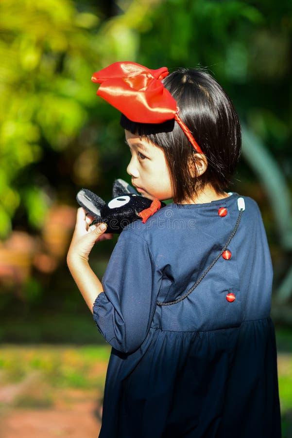 A girl dressed as Kiki. stock photos