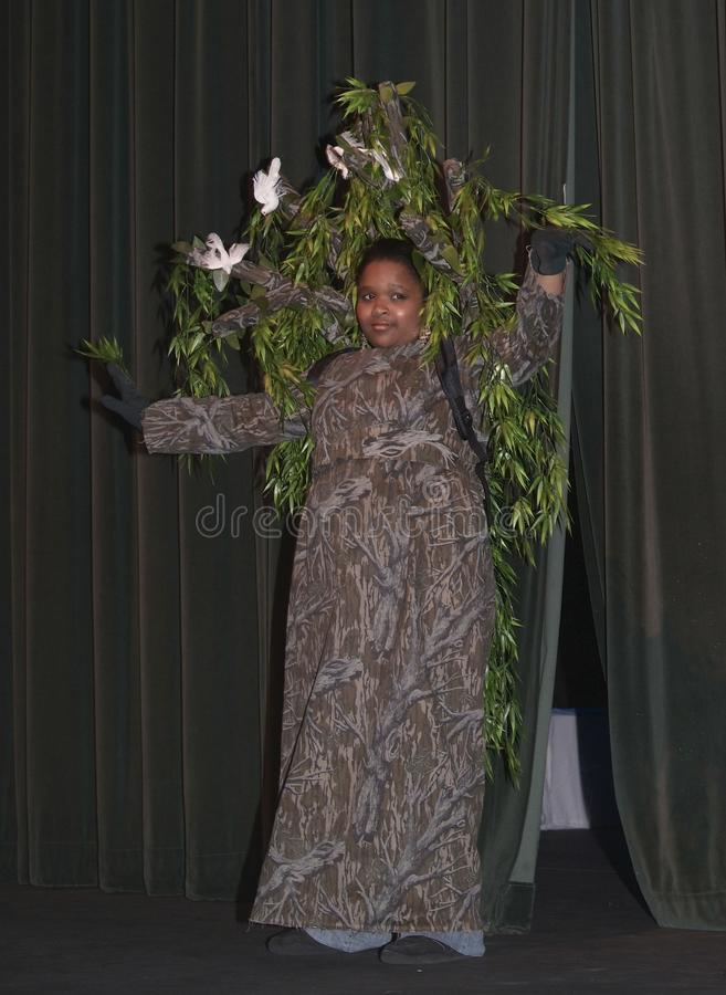 Girl dressed as a tree in a play royalty free stock images