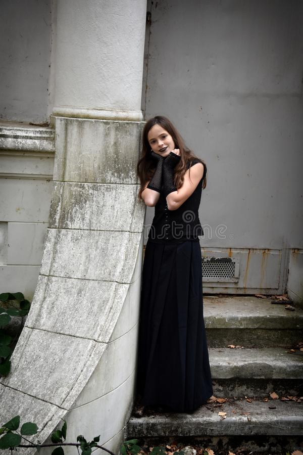 Girl dressed in black in a spooky surrounding stock images