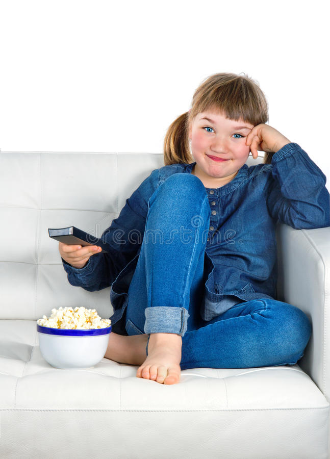 Download Girl Dressed In Blue Denim Watching TV Stock Image - Image: 27117173
