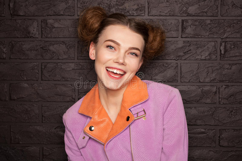 Girl dressed in pink jacket smiling royalty free stock photography