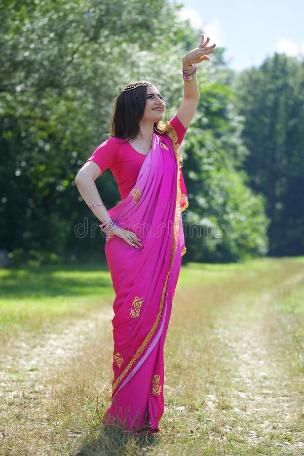 The girl, dressed in a Sari of Indian culture. stock image