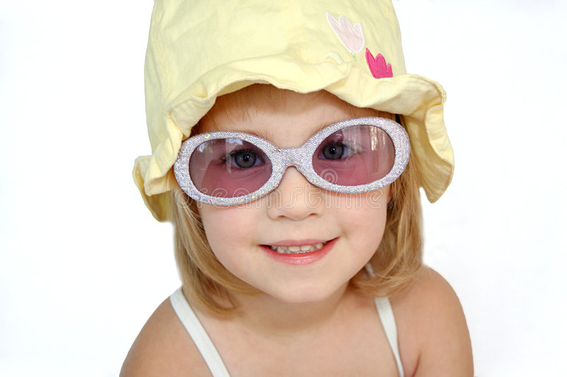 Girl Dressed for Swimming. A little girl is dressed and ready to go play in the sun royalty free stock images