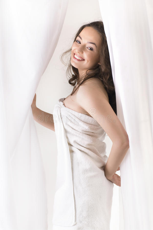 Girl dressed in towel royalty free stock photo