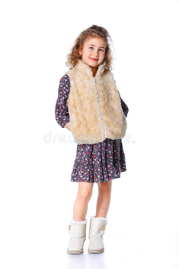 Girl dressed for winter. A beautiful young girl dressed for winter, over a white background stock photography