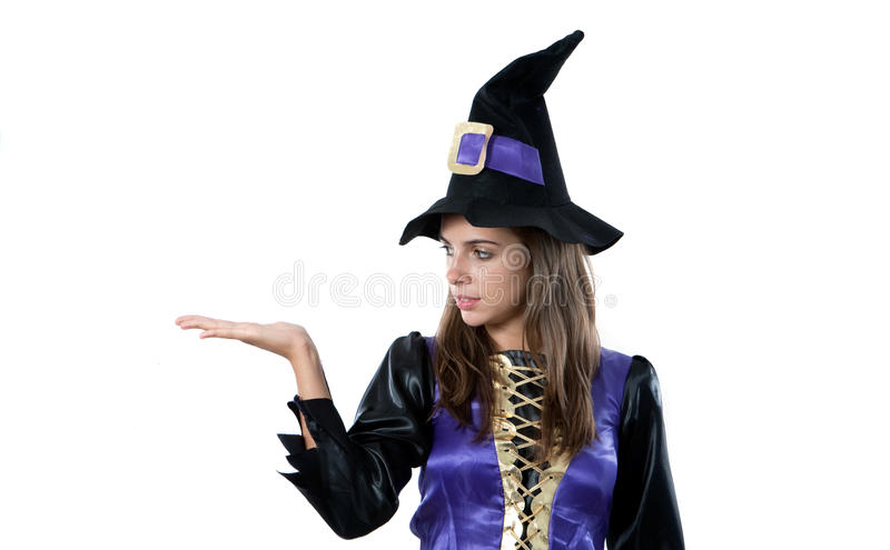 Girl dressed in witch. Isolated on white background royalty free stock images