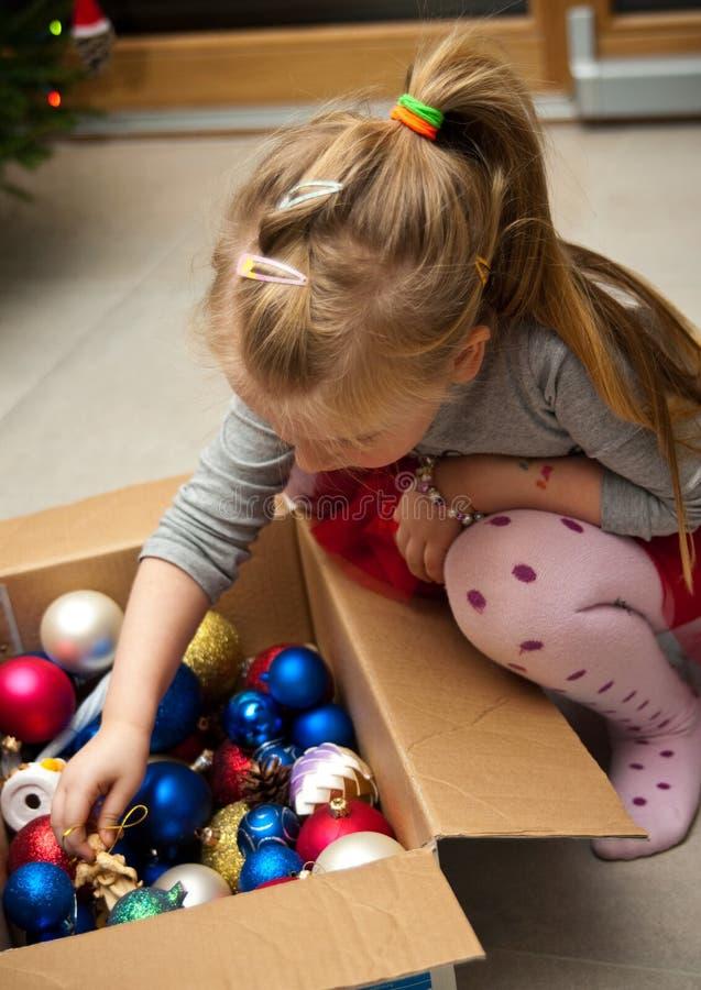 Girl dressing Christmas tree royalty free stock photo