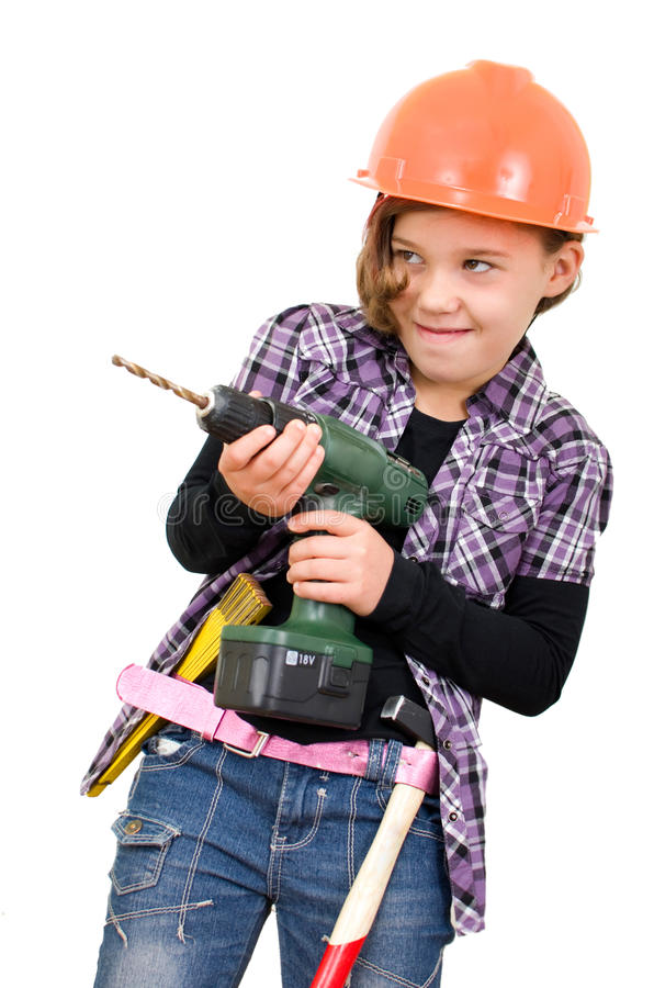 Girl with a drill. Girlsas a craftsman with a drill royalty free stock photography