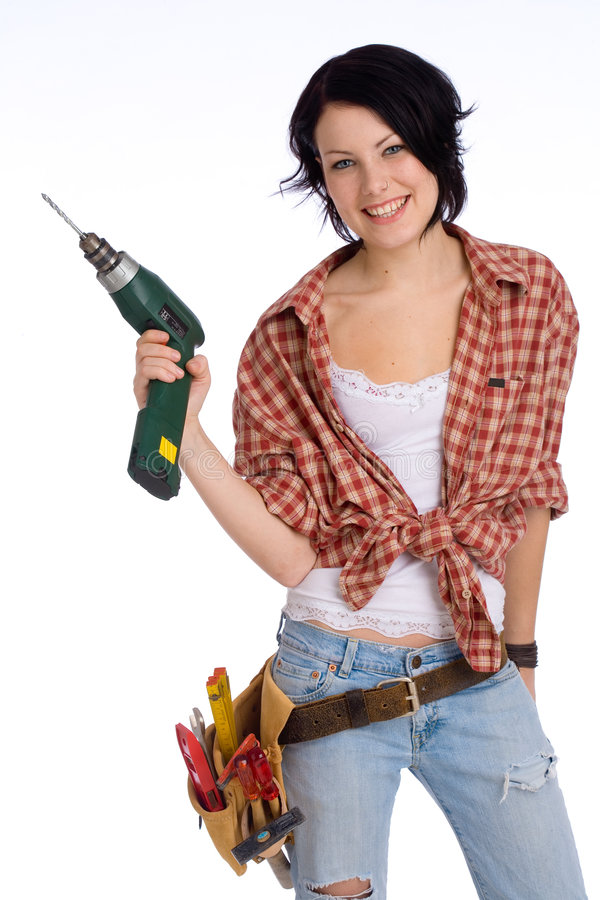 Girl with drilling machine. Young do-it-yourselfer with a drilling machine stock photos