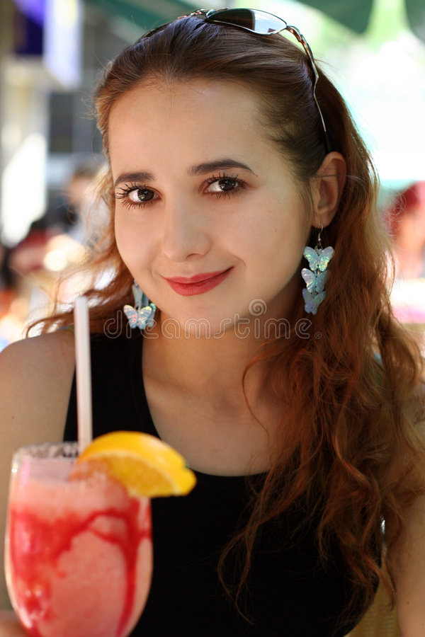 Girl with a drink stock photo