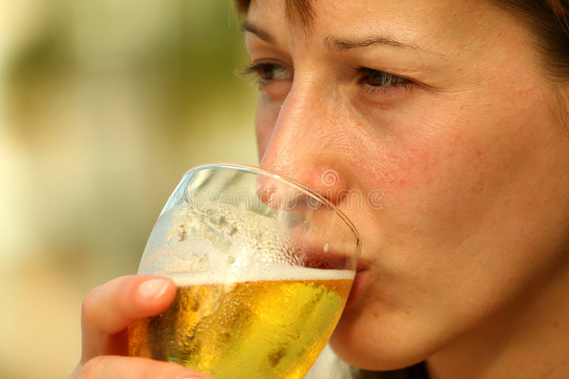 Girl drinking beer royalty free stock images