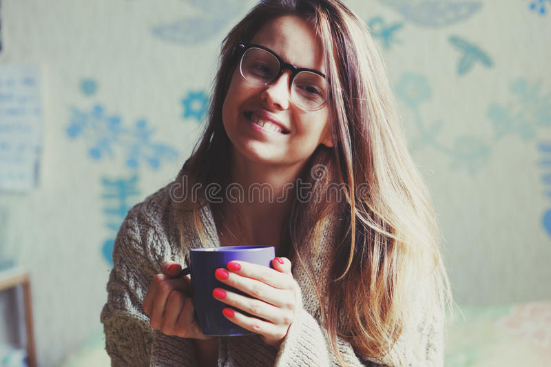 Girl drinking coffee in bed stock photos