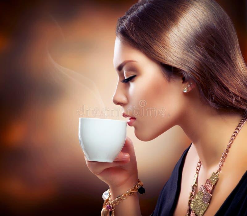 Girl Drinking Coffee or Tea royalty free stock photo