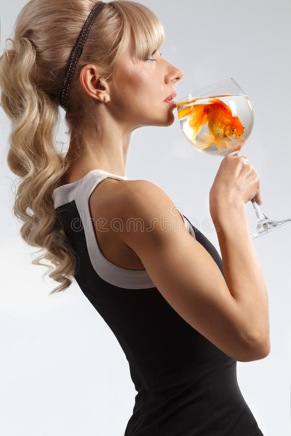 Download Girl Drinking Glass Of Water With Golden Fish Stock Image - Image: 28329043