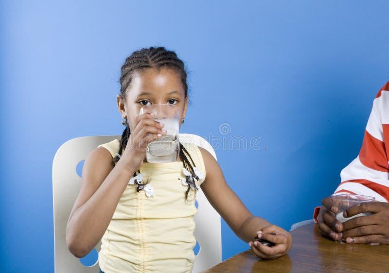 Girl drinking milk stock photos