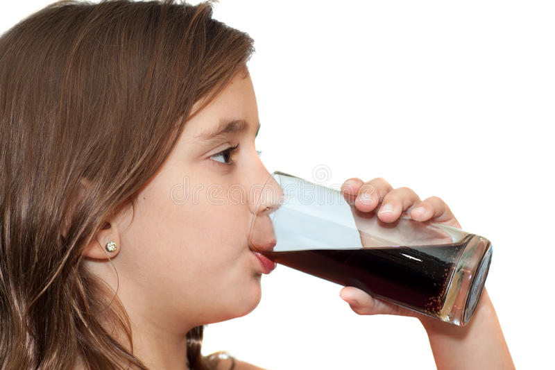 Girl drinking a soft drink royalty free stock images