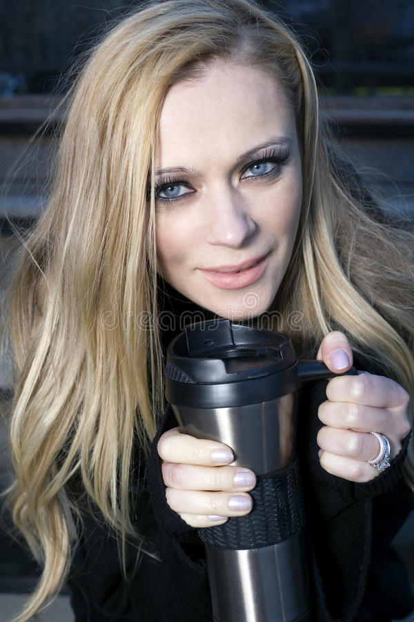 Girl with drinking thermos