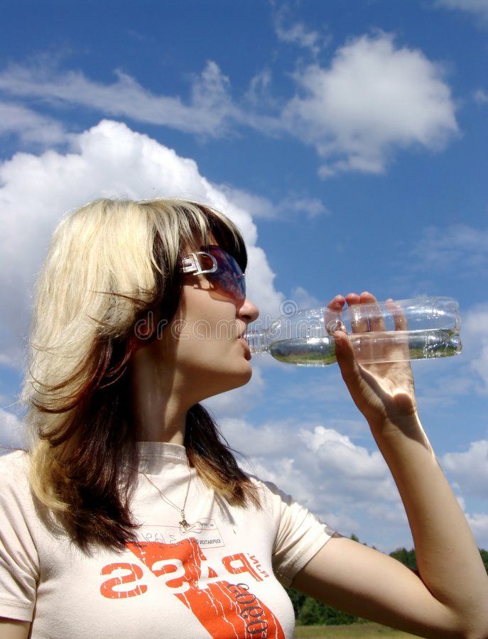 The girl drinking water royalty free stock photos