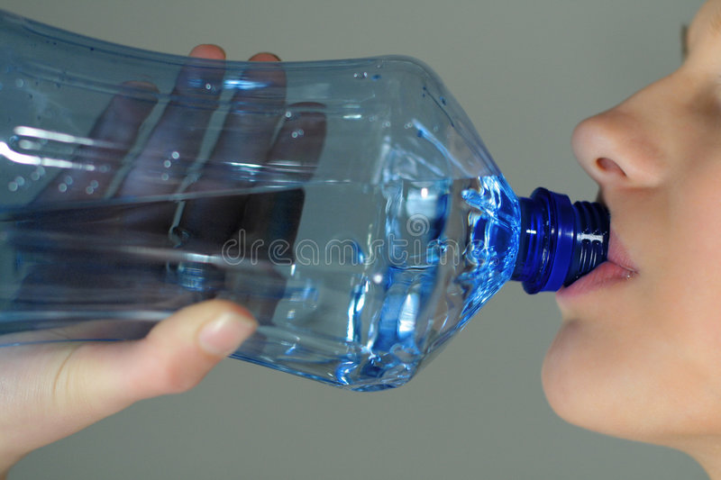 Download The girl drinking water stock image. Image of hold, freshness - 1076733